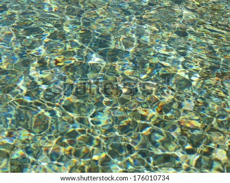 water surface with sunlight shining over it - useful as a background or holidays concept
