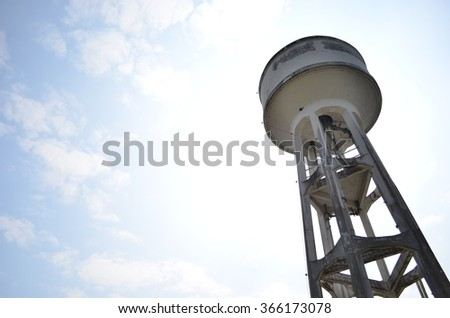Water tank , water supply tank for agriculture with blue sky background - stock photo