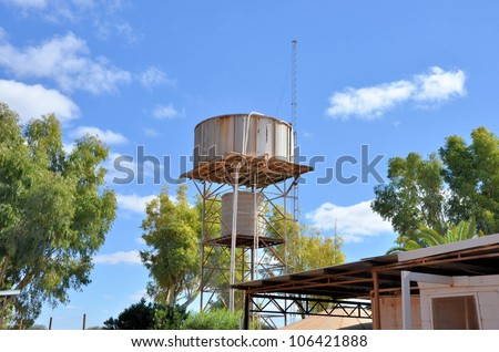 Water Tanks in a Farm in the Australian Outback and Blue Sky