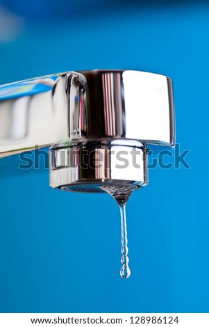 Water tap and drops of water - stock photo