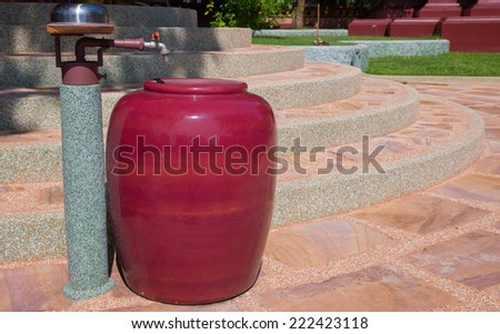 water tap and red Jar - stock photo