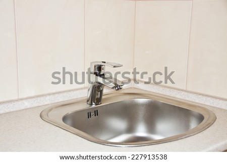 water tap and sink in a modern kitchen