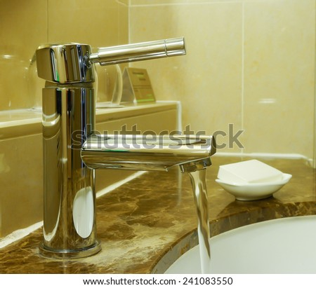 water tap in hotel room - stock photo