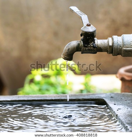 Water tap in nature background.  - stock photo