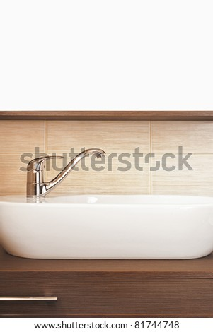 Water tap in the bathroom with wooden stand - stock photo