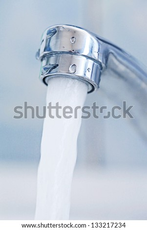 Water tap. Macro image with selective focus. - stock photo