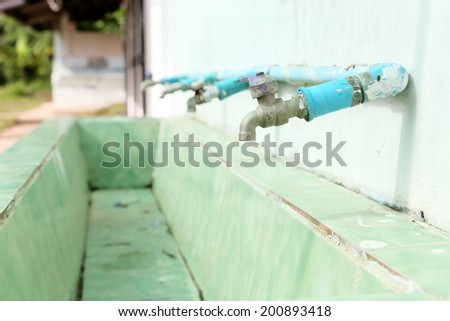 Water taps in a public school. Thailand  - stock photo