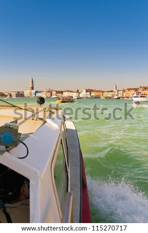 Water Taxi on its way back from Murano island to San Marco square located at Venice, Italy