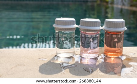 Water testing at swimming pool - stock photo