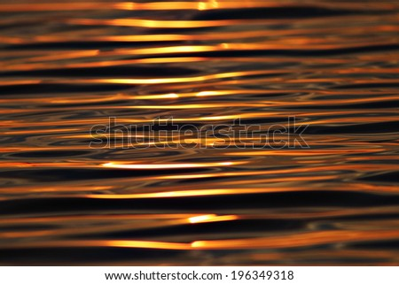 water texture steel sunset orange