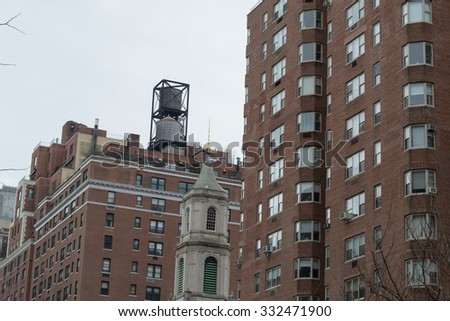 Water tower are iconic in NYC and their function is the distribution of potable water and providing emergency storage for fire protection - stock photo