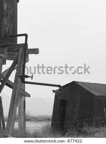 water tower on farm - stock photo