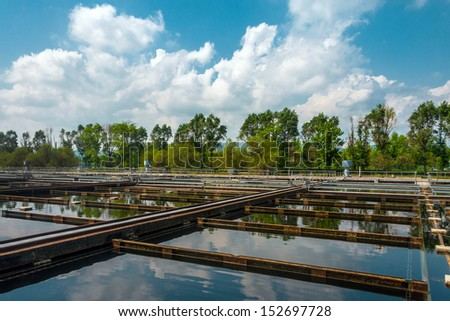Water treatment facility with large pools of water - stock photo