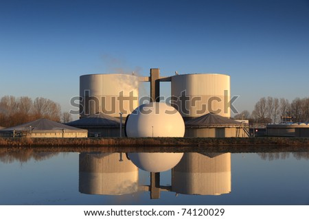 Water treatment plant in the warm sunlight of a spring morning. - stock photo