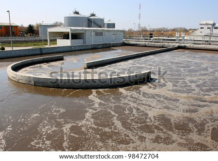 Water treatment plant on sunny day recycling polluted water - stock photo