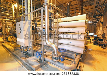 Water treatment plant with low energy yellow sodium lighting - stock photo