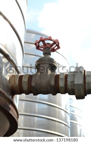 Water valve connects to  pipe. - stock photo