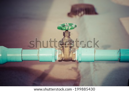 Water valve connects to PVC pipe, process color - stock photo