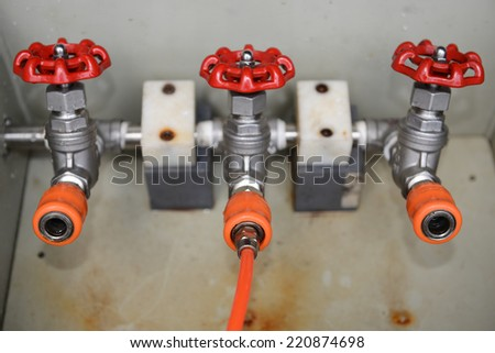 water valve pump test coiled orange hose  - stock photo