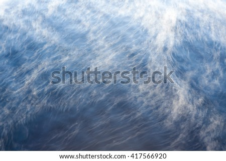 Water vapor on surface of cold water - stock photo