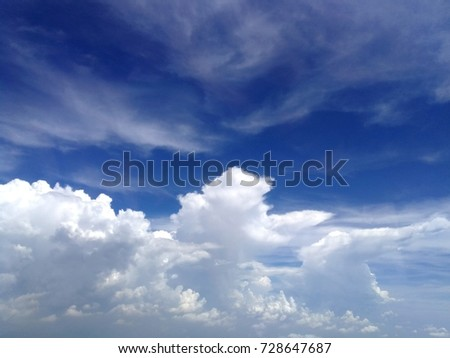 water vapour in the air condense to form storm cumulus cloud, huge fluffy, and stratus cloud, scattered cloud, with blue sky background