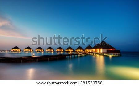 Water villas in hotel resort, Indian ocean, Maldives - stock photo