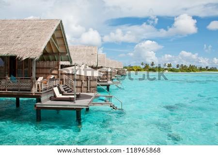 Water villas in the ocean - stock photo