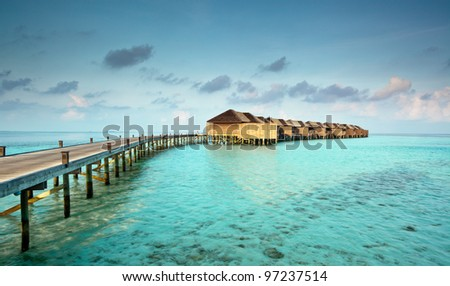 Water villas of a luxury resort in the Maldives