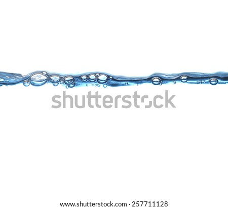 Water wave with air bubbles isolated in white background - stock photo