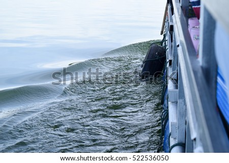 Water waves caused by the ship's side.