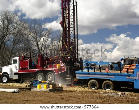 Water well is drilled by workmen - stock photo