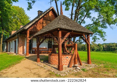 Water well of a traditional rural house in Radziejowice village on sunny summer day, Poland