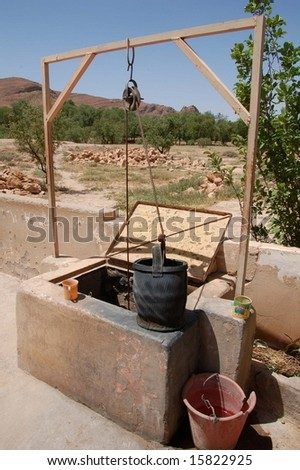 water well pail in alto atlas morocco africa - stock photo