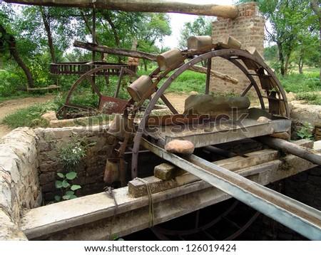 water well wheel with bucket pakistan - stock photo