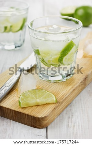 Water with ice and limes - stock photo