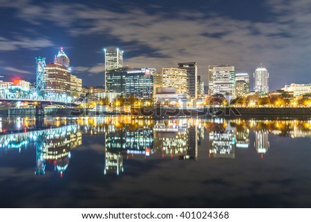water with reflection and cityscape and skyline of portland at night
