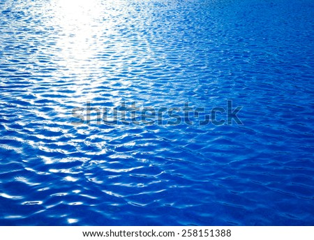 water with sun reflections - stock photo