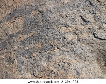 Water worn Stone Rock Close-up with line and cut pattern. - stock photo