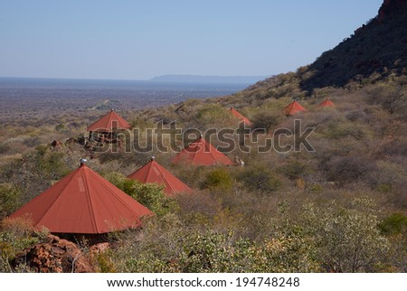 WATERBERG, NAMIBIA - JULY 24, 2013: Red roofs of the Waterberg Plateau Lodge in Namibia nestling high on the slope of Waterberg with views across the endless Kalahari.