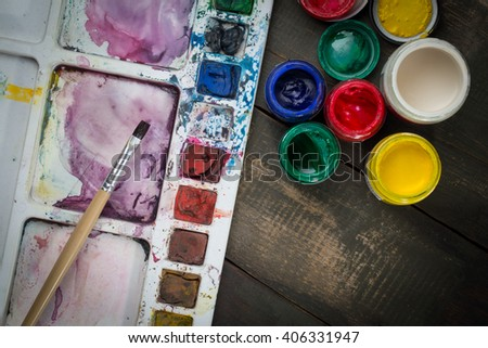 watercolor paint tray with brush