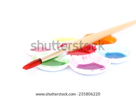 Watercolor paint with brush. - stock photo