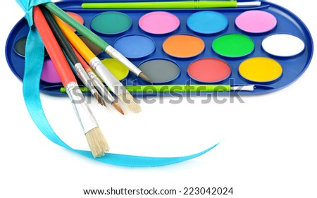 watercolor paints and brushes isolated on white background - stock photo