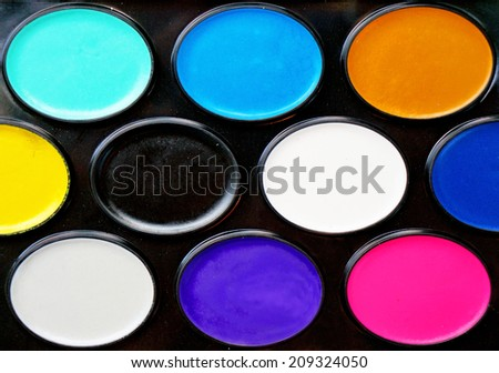 Watercolor paints in a box close up as background                                - stock photo