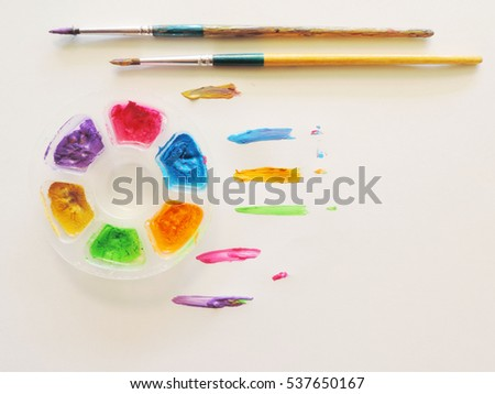 Watercolor palette with paintbrush,Learning the art of children in school.