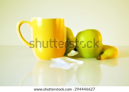 Watercolor style blurry breakfast background. Food presentation illustration. Yellow mug with fruits. Apples, banana.