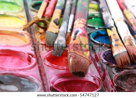Watercolors with messy brushes - stock photo