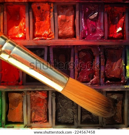 Watercolour paints and paintbrush close-up