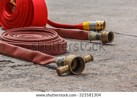 Watercourse fire extinguisher red ready to use in the outdoor. - stock photo