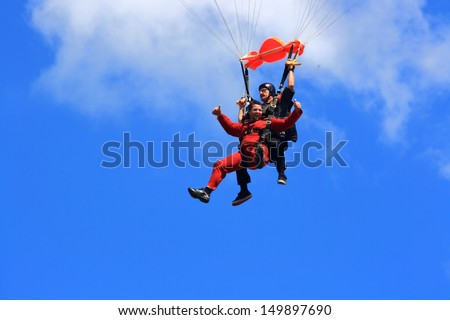 WATERDOWN, ONTARIO/CANADA - AUGUST 2013: Skydivers in tandem jump  on the way to the Earth on August 4, 2013 in Waterdown. First time jumper in joy from first free fly in jump on Civic holiday.