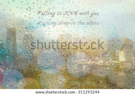 Waterdrops on a glass surface windows with falling in Love with you qoutes on cityscape background - stock photo